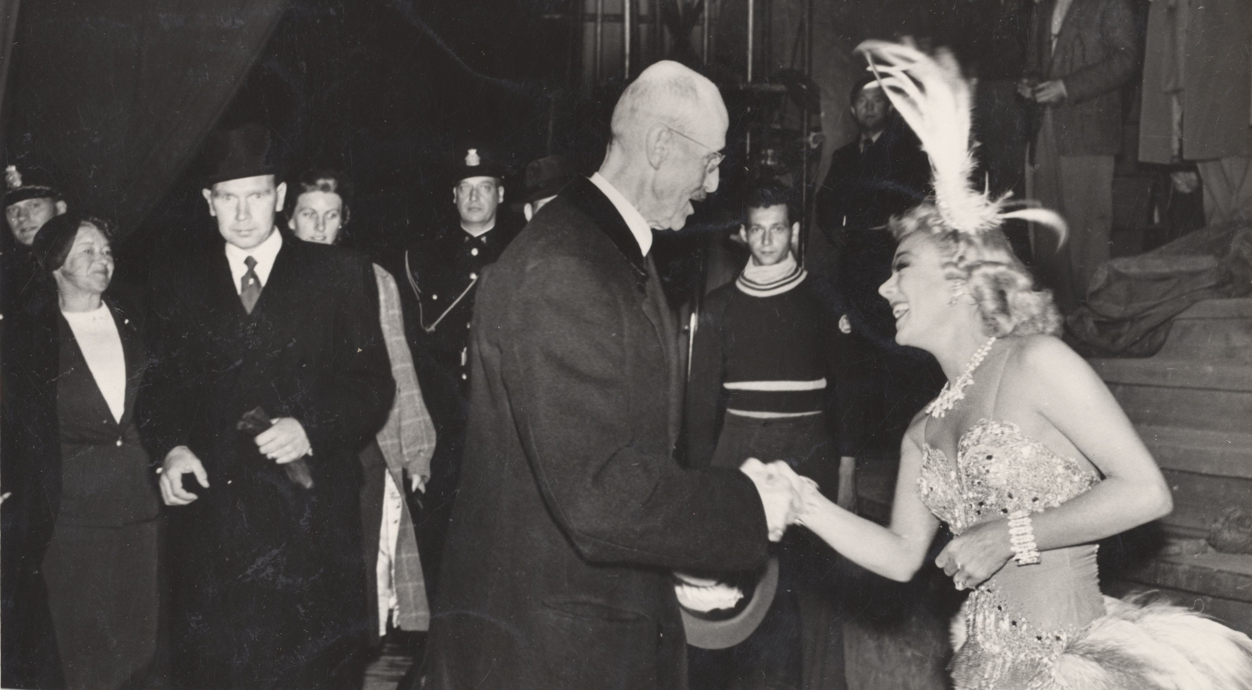King Haakon greets Sonja Henie after a skating show at Jordal Amfi